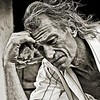 Homeless: My hour with Michael Stout : Michael Stout is a homeless man in his early 50s, living in Gulfport, Mississippi.  He is originally from Newport News, Virginia, but now lives barely hanging on in Gulfport. On a day that we had tropical storm force winds and some flooding caused by Hurricane Ike,  I watched Michael riding his bike, weaving back and forth as he made his way through traffic.  I feared for his safety because he was obviously under the influence of alcohol.  I followed him down a quiet dreary street of delapidated or burned out shotgun houses.  Not the sort of place I usually frequent!  I had been photographing the effects of the storm nearby on the beach and was still in the mood to shoot (as always!)  I watched him hide from me beside a house and snapped a picture of him, which I instantly realized was wrong.  He didn't seem too pleased, so I asked him if I could take his picture.  He said no thanks, he didn't believe so.  I offered him $10 and he said he would do anything I wanted.  (LOL)   